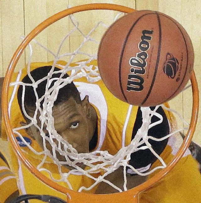 Tennessee's Josh Richardson looks up at a ball during the first half of an NCAA Midwest Regional semifinal college basketball tournament game against the Michigan Friday, March 28, 2014, in Indianapolis. (AP Photo/Michael Conroy)