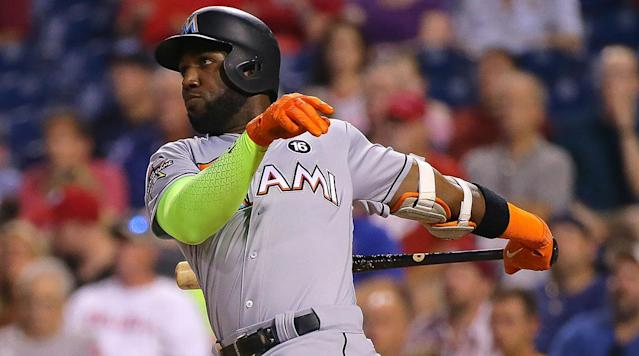 "<p>The St. Louis Cardinals have acquired outfielder Marcell Ozuna in a trade with the Miami Marlins, <a href=""https://twitter.com/CraigMish/status/941004846035034113"" rel=""nofollow noopener"" target=""_blank"" data-ylk=""slk:according"" class=""link rapid-noclick-resp"">according</a> to Craig Mish of Sirius XM.</p><p>The deal is pending a physical, <a href=""https://twitter.com/JesseSanchezMLB/status/941005900323741697"" rel=""nofollow noopener"" target=""_blank"" data-ylk=""slk:according"" class=""link rapid-noclick-resp"">according</a> to MLB.com's Jesse Sanchez.</p><p>Further details about who is headed to the Marlins have not been disclosed yet. </p><p>Ozuna finished last season as an All-Star, Silver Slugger and Gold Glove award winner after hitting 37 home runs with a .312 batting average and 124 RBIs. Ozuna is in his second season of arbitration eligibility and will not hit the free agent market until after the 2020 season. </p><p>The Cardinals were interested in Giancarlo Stanton before he was traded to the New York Yankees in exchange for second baseman Starlin Castro and prospects. The Marlins had agreed to the framework of a deal with the Cardinals and Stanton met with the team before rejecting the trade.</p><p>The Cardinals already have Tommy Pham, Dexter Fowler and Stephen Piscotty on their roster as outfield options.</p>"