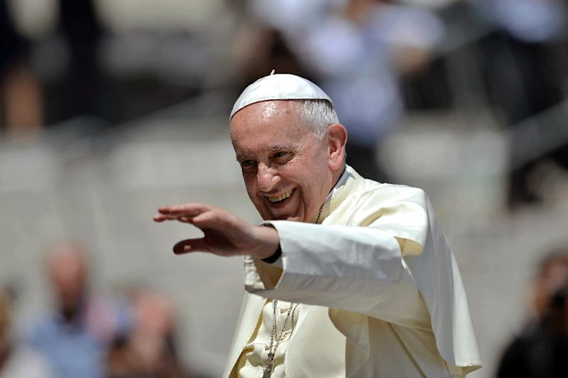 Pope Francis blesses the crowd at the Vatican on June 24, 2015