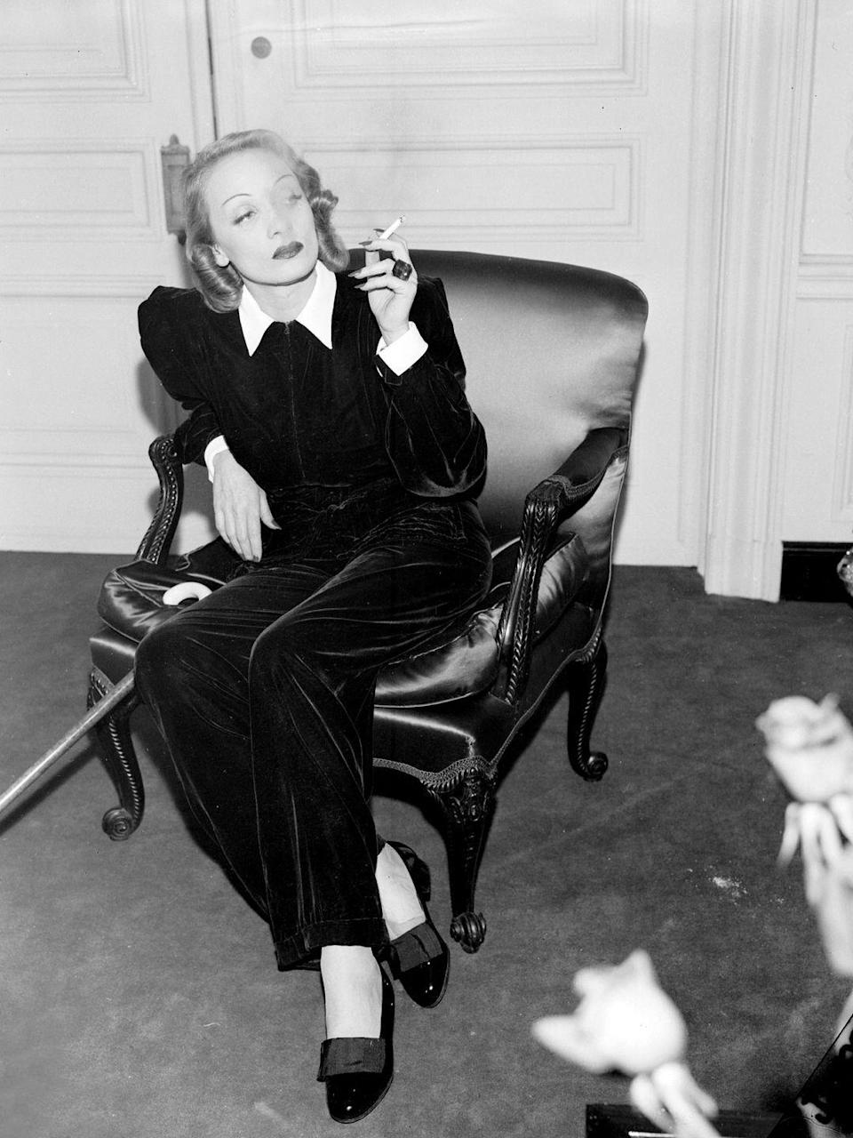 <p>Dietrich is caught lounging in a velvet pantsuit at the St. Regis Hotel in New York City. The actress and singer was very outspoken against her home country during World War II and performed over 500 times, sometimes near the front lines, for the Allied troops between 1943 and 1946. <br></p>