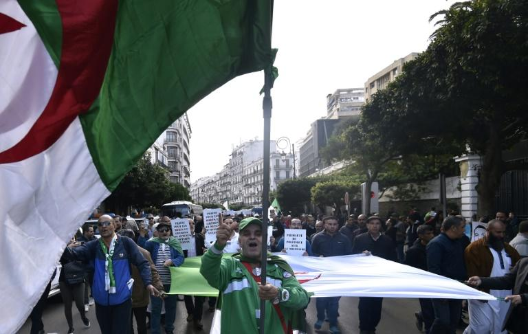 Algerians seem divided as their protest movement is almost one year old on what steps to take after the December presidential election of former prime minister Amdelmajid Tebboune to replace veteran leader Abdelaziz Bouteflika (AFP Photo/RYAD KRAMDI                        )
