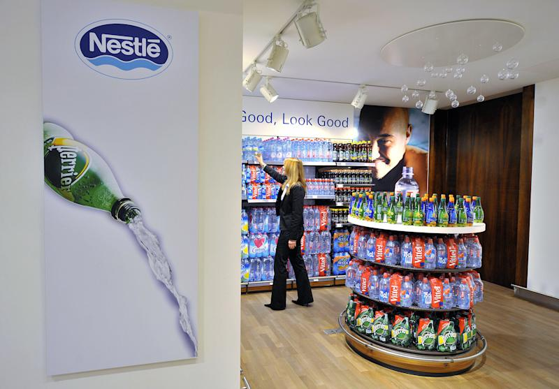Nestle waters from the brand Vittel, Perrier and Contrex are seen on February 21, 2008 in a supermarket at company headquarters in Vevey. The world's number one food manufacturer, based in Switzerland, said on February 21, 2008 its net profit rose 15.8 percent last year to 10.65 billion Swiss francs (9.7 billion dollars/6.6 billion euros), with growth expected in 2008. Sales grew by 9.2 percent in 2007 to 107.6 billion Swiss francs, Nestle said in a statement. AFP PHOTO / FABRICE COFFRINI (Photo credit should read FABRICE COFFRINI/AFP/Getty Images)