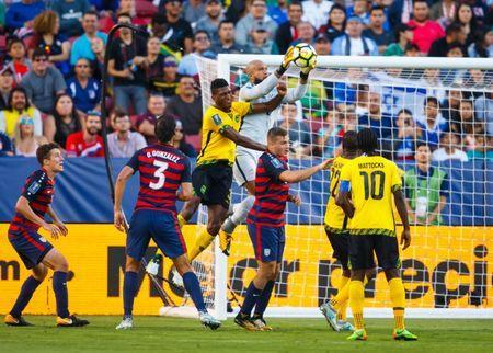 Jul 26, 2017; Santa Clara, CA, USA; United States goalkeeper Tim Howard (center) blocks a shot on goal by Jamaica defender Damion Lowe in the first half during the CONCACAF Gold Cup final at Levi's Stadium. Mandatory Credit: Mark J. Rebilas-USA TODAY Sports