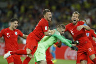 <p>Harry Kane, Kieran Trippier, and John Stones mob goalkeeper Jordan Pickford after England won their first penalty shoot-out since 1996. </p>