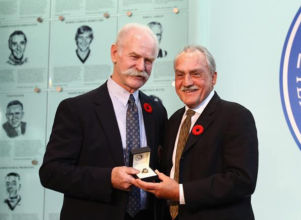 TORONTO, ON - NOVEMBER 11: (L-R) Lanny McDonald, Chairman of the Hockey Hall of Fame presents Rogatien Vachon with his Hall ring during a photo opportunity at the Hockey Hall Of Fame on November 11, 2016 in Toronto, Canada. (Photo by Bruce Bennett/Getty Images)