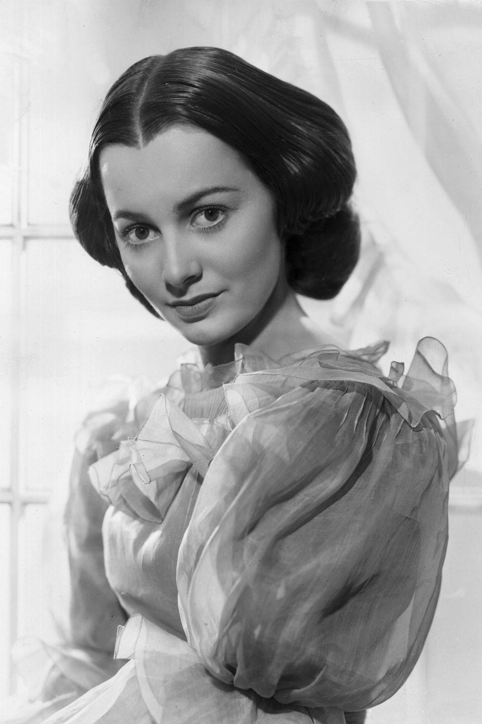 <p>Decked in frills and ruffles for a photo promoting <em>Gone with the Wind</em>. </p>
