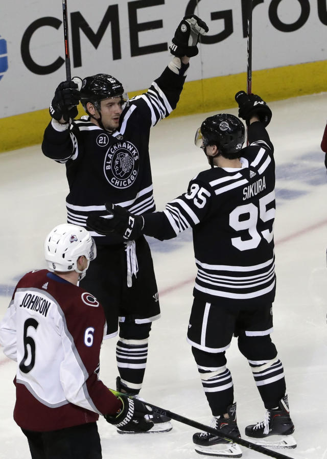 Chicago Blackhawks center Artem Anisimov, left, celebrates with right wing Dylan Sikura after scoring a goal against the Colorado Avalanche during the third period of an NHL hockey game Sunday, March 24, 2019, in Chicago. The Blackhawks won 2-1 in overtime. (AP Photo/Nam Y. Huh)