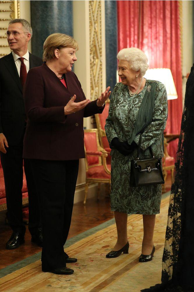 Chancellor of Germany Angela Merkel talks to Queen Elizabeth at a reception for NATO leaders at Buckingham Palace