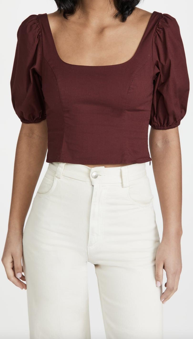 <p>Got a cute brunch date coming up? You'll stand out in this <span>STAUD Papaya Top</span> ($148, originally $185) paired with a gold chain necklace.</p>