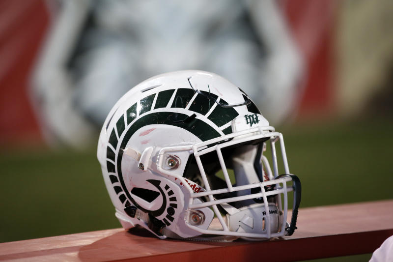 A Colorado State helmet rests on the bench during the second half of an NCAA college football game against New Mexico on Friday, Oct. 11, 2019 in Albuquerque, N.M. (AP Photo/Andres Leighton)