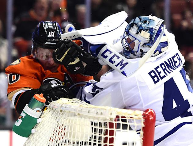 ANAHEIM, CA - JANUARY 06: Jonathan Bernier #45 of the Toronto Maple Leafs and Corey Perry #10 of the Anaheim Ducks push during the third period of a a 4-0 Leaf win at Honda Center on January 6, 2016 in Anaheim, California. (Photo by Harry How/Getty Images)