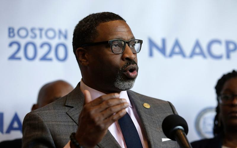 In this Thursday, Dec. 12, 2019, file photo, National Association for the Advancement of Colored People President Derrick Johnson faces reporters during a news conference in Boston - Steven Senne/AP