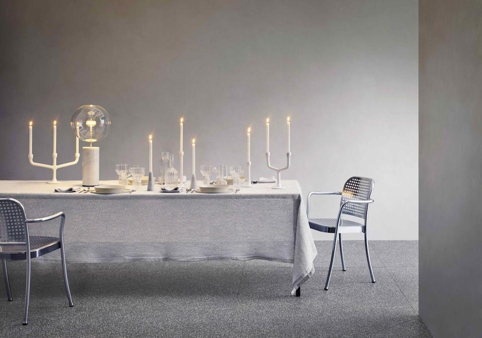 """<p>Evoke dreams of a cool, white Christmas, with this stripped-back palette of snow-and-ice shades. Add glowing candles and a contemporary glass lamp for a sophisticated Scandi feel.</p><p>'Tab' <strong>tablecloth</strong>, from £235; 'Tab' <strong>napkins</strong>, £25 each, both Society Limonta (<u><a href=""""https://eu.societylimonta.com/collections/napkins"""" rel=""""nofollow noopener"""" target=""""_blank"""" data-ylk=""""slk:uk.societylimonta.com"""" class=""""link rapid-noclick-resp"""">uk.societylimonta.com</a></u>). 'Esag' <strong>candleholders</strong>, from approx £45, Atipico (<u><a href=""""https://www.atipico.it/Products.aspx"""" rel=""""nofollow noopener"""" target=""""_blank"""" data-ylk=""""slk:shop.atipico.it"""" class=""""link rapid-noclick-resp"""">shop.atipico.it</a></u>). 'Bolle Soffio' white marble and brass <strong>table light </strong>by Giopato & Coombes, £1,692, Viaduct (<u><a href=""""https://www.viaduct.co.uk/brands/giopato-and-coombes"""" rel=""""nofollow noopener"""" target=""""_blank"""" data-ylk=""""slk:viaduct.co.uk"""" class=""""link rapid-noclick-resp"""">viaduct.co.uk</a></u>). 'May' <strong>flutes</strong>, approx £155 for a set of two; 'Margot' <strong>decanter</strong>, approx £248; 'Margot' <strong>wine goblets</strong>, approx £171 for a set of two, all Fferrone (<u><a href=""""https://fferronedesign.com/products/margot-decanter"""" rel=""""nofollow noopener"""" target=""""_blank"""" data-ylk=""""slk:fferronedesign.com"""" class=""""link rapid-noclick-resp"""">fferronedesign.com</a></u>). 'Silver' <strong>chairs</strong> by Vico Magistretti, from £856, De Padova (<u><a href=""""https://www.depadova.com/product/silver/"""" rel=""""nofollow noopener"""" target=""""_blank"""" data-ylk=""""slk:depadova.com"""" class=""""link rapid-noclick-resp"""">depadova.com</a></u>)</p>"""