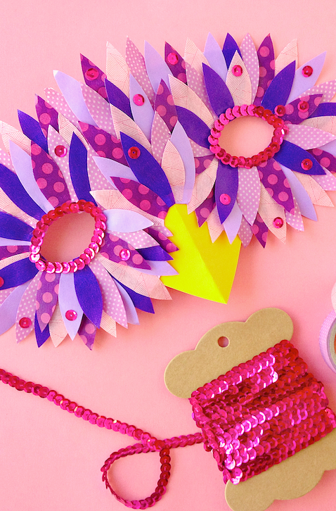 """<p>Colorful paper, printed washi tape, and a string of sequins are all you need to make this gorgeous piece at home.</p><p><strong>Get the tutorial at <a href=""""http://www.omiyageblogs.ca/2014/10/make-bird-mask.html"""" rel=""""nofollow noopener"""" target=""""_blank"""" data-ylk=""""slk:Omiyage Blogs"""" class=""""link rapid-noclick-resp"""">Omiyage Blogs</a>.</strong></p><p><a class=""""link rapid-noclick-resp"""" href=""""https://www.amazon.com/Linsoir-Spangle-Sequins-Paillette-String/dp/B01DU3RTDY/?tag=syn-yahoo-20&ascsubtag=%5Bartid%7C10050.g.3480%5Bsrc%7Cyahoo-us"""" rel=""""nofollow noopener"""" target=""""_blank"""" data-ylk=""""slk:SHOP PINK SEQUINS"""">SHOP PINK SEQUINS</a> </p>"""