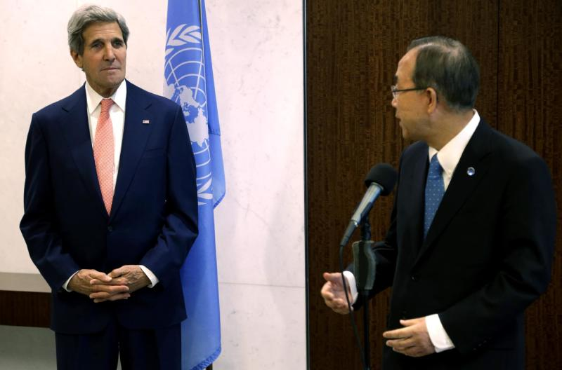 United States Secretary of State John Kerry, left, listens while United Nations Secretary-General Ban Ki-moon makes some remarks before a meeting at United Nations Headquarters in New York, Thursday, July 25, 2013. Kerry will preside at a U.N. Security Council meeting assessing progress in implementing a Feb. 24 peace accord signed by 11 African nations to end years of fighting in eastern Congo. Later, he will meet with leaders of the Western-backed Syrian National Coalition to promote an international conference and a political solution to the conflict. On Thursday, U.N. Secretary-General Ban Ki-Moon announced that the conflict has claimed more than 100,000 lives since 2011, up from an earlier estimate of 93,000. (AP Photo/Seth Wenig)