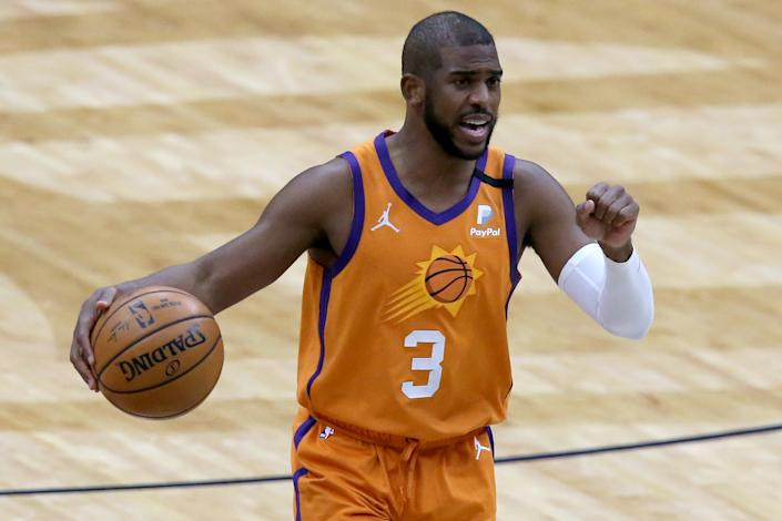 Chris Paul #3 of the Phoenix Suns dribbles the ball down court during the fourth quarter of an NBA game against the New Orleans Pelicans at Smoothie King Center on February 19, 2021 in New Orleans, Louisiana. NOTE TO USER: User expressly acknowledges and agrees that, by downloading and or using this photograph, User is consenting to the terms and conditions of the Getty Images License Agreement. (Photo by Sean Gardner/Getty Images)