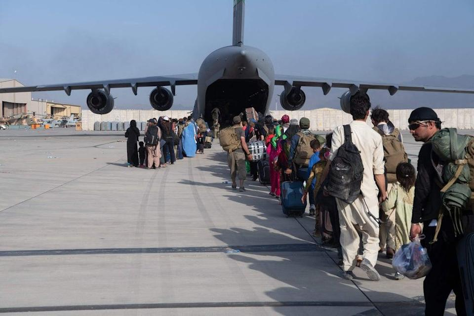 An evacuation flight out of  Hamid Karzai International Airport in Kabul overseen by US Air Force personnel (US Air Force/AFP/Getty)
