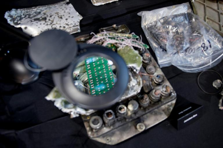 A magnifying glass shows a part of the guidance system of an Iranian Qiam Ballistic Missile that the US presented as evidence that Iran violated a UN arms embargo in Yemen
