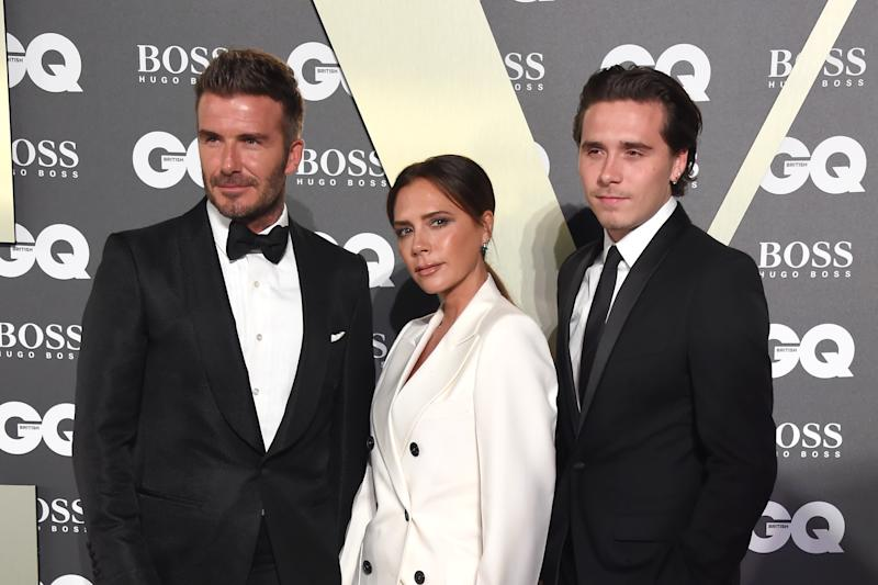LONDON, ENGLAND - SEPTEMBER 03: David Beckham, Victoria Beckham and Brooklyn Beckham attend GQ Men Of The Year Awards 2019 in association with HUGO BOSS at Tate Modern on September 03, 2019 in London, England. (Photo by David M. Benett/Dave Benett/Getty Images for Hugo Boss)