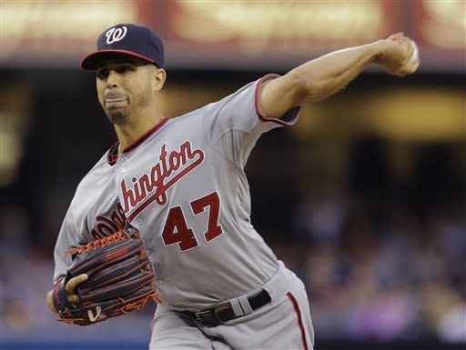 Washington Nationals starting pitcher Gio Gonzalez works against the San Diego Padres in the first inning of a baseball game in San Diego, Friday, May 17, 2013. (AP Photo/Lenny Ignelzi)