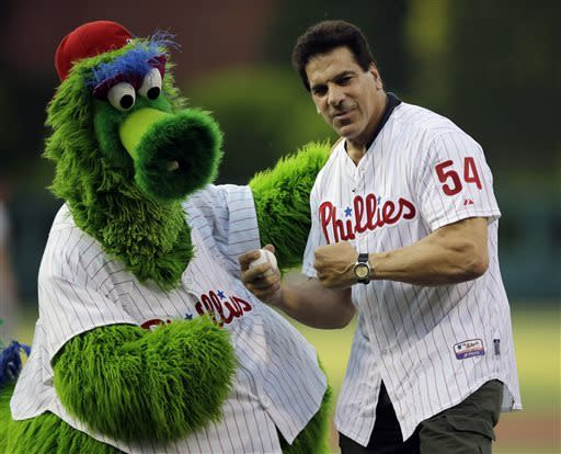 Actor Lou Ferrigno, right, poses with the Philadelphia Phillies mascot, the Phillie Phanatic, after Ferrigno threw out a ceremonial first pitch before an interleague baseball game between the Phillies and the Boston Red Sox, Thursday, May 30, 2013, in Philadelphia. (AP Photo/Matt Slocum)