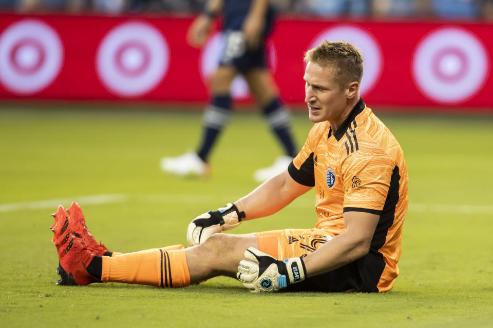 Sporting Kansas City goalkeeper Tim Melia reacts after conceding a goal during the first half of an MLS soccer match against the Seattle Sounders, Sunday, Sept. 26, 2021, in Kansas City, Kan. (AP Photo/Nick Tre. Smith)