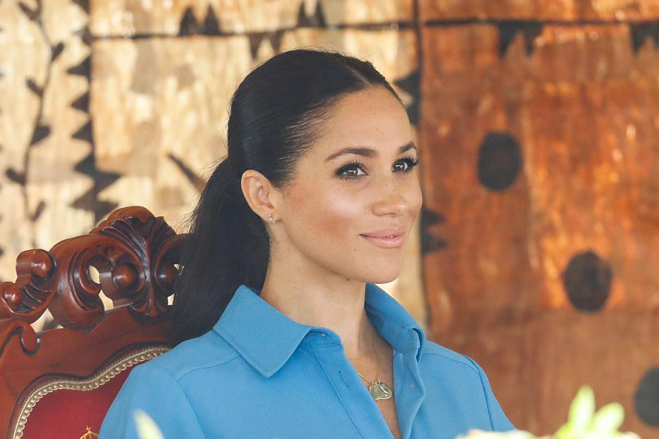 NUKU'ALOFA, TONGA - OCTOBER 26:  Prince Harry, Duke of Sussex and Meghan, Duchess of Sussex attend Unveiling of The Queen's Commonwealth Canopy at Tupou College on October 26, 2018 in Nuku'alofa, Tonga. The Duke and Duchess of Sussex are on their official 16-day Autumn tour visiting cities in Australia, Fiji, Tonga and New Zealand.  (Photo by Chris Jackson/Getty Images)