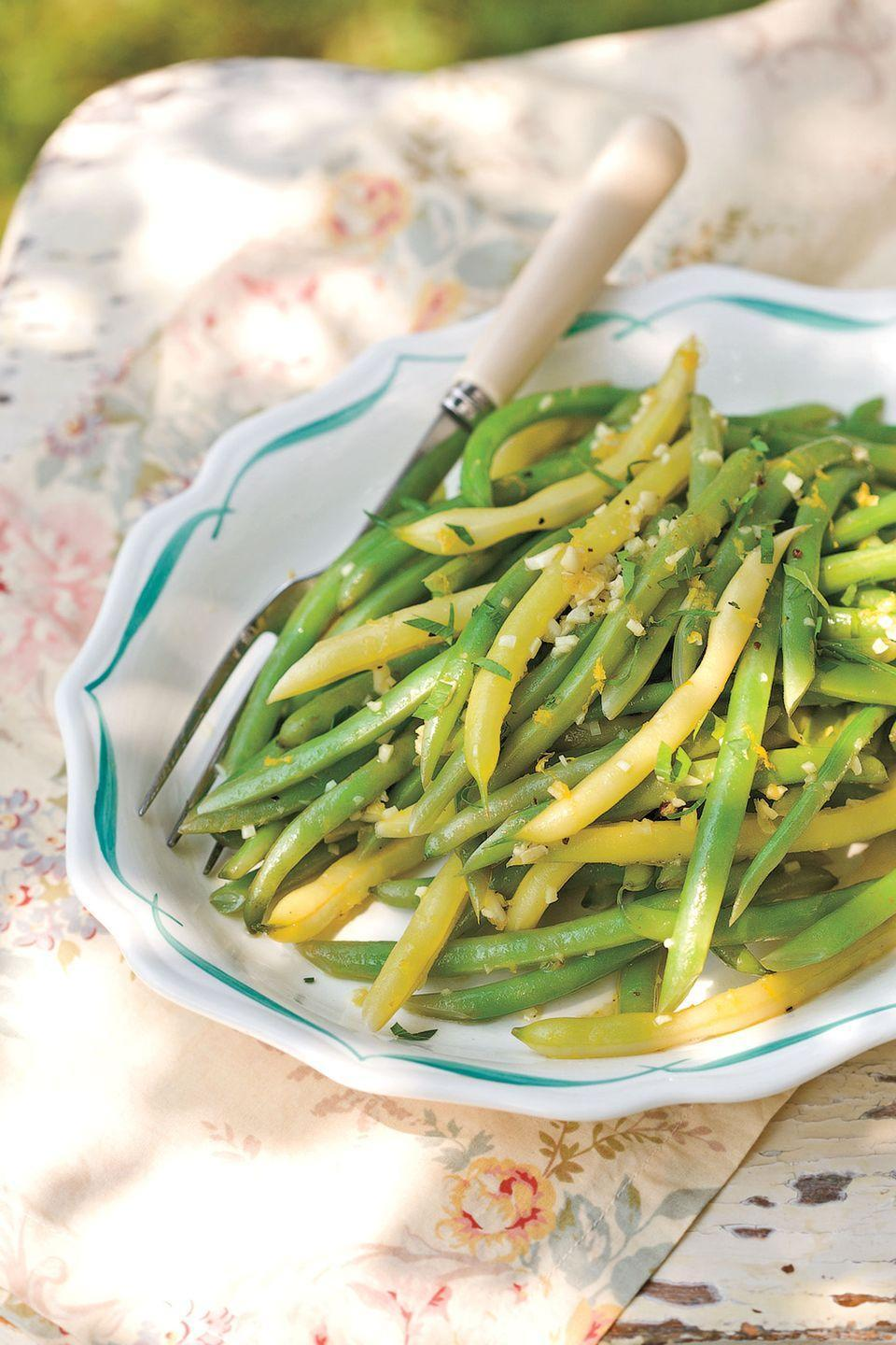 "Punch up this side-dish recipe fast with the hardworking supermarket standby, orange juice concentrate. <a href=""https://www.countryliving.com/food-drinks/recipes/a2840/green-beans-orange-beurre-blanc-recipe/"" rel=""nofollow noopener"" target=""_blank"" data-ylk=""slk:Get the recipe."" class=""link rapid-noclick-resp""><strong>Get the recipe.</strong></a>"