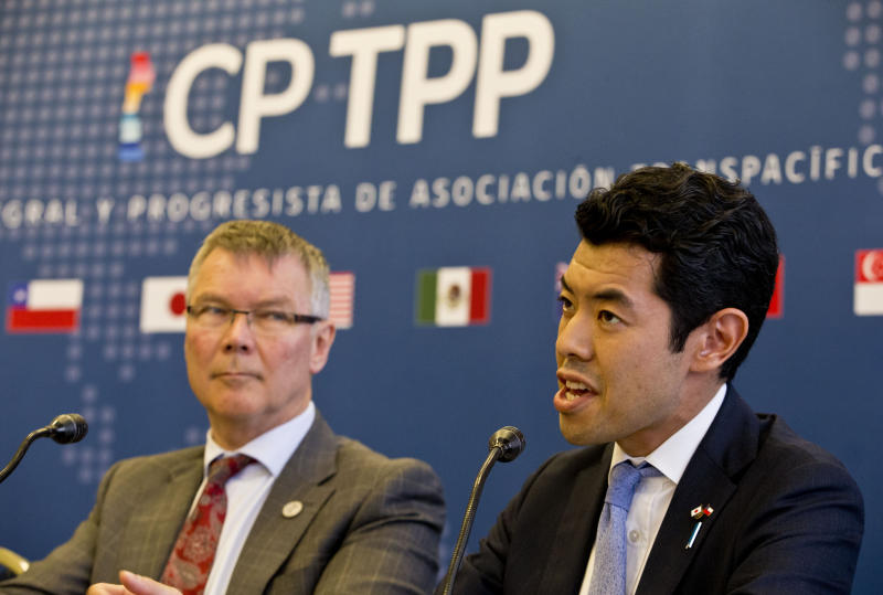 Kiyoto Tsuji, Parliamentary Vice-Minister of Foreign Affairs of Japan, talks next to David Parker, Minister for Trade and Export Growth of New Zealand during a meeting of the Comprehensive and Progressive Agreement for Trans-Pacific Partnership, CP TPP, in Santiago, Chile, Thursday, May 16, 2019. (AP Photo/Esteban Felix)