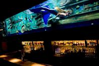 """<p><em>Sacramento, CA</em></p><p>This isn't your typical hole-in-the-wall dive bar. What sets <a href=""""http://divebarsacramento.com/_about.html"""" rel=""""nofollow noopener"""" target=""""_blank"""" data-ylk=""""slk:this Sacramento-mermaid attraction"""" class=""""link rapid-noclick-resp"""">this Sacramento-mermaid attraction</a> apart from the rest is that the live sea-people swim directly above the bar. No matter where you stand, everyone will have a view of the special show. Just look up. </p><p>Photo: Facebook/<a href=""""https://www.facebook.com/DiveBarSacramento/"""" rel=""""nofollow noopener"""" target=""""_blank"""" data-ylk=""""slk:DiveBarSacramento"""" class=""""link rapid-noclick-resp"""">DiveBarSacramento</a></p>"""