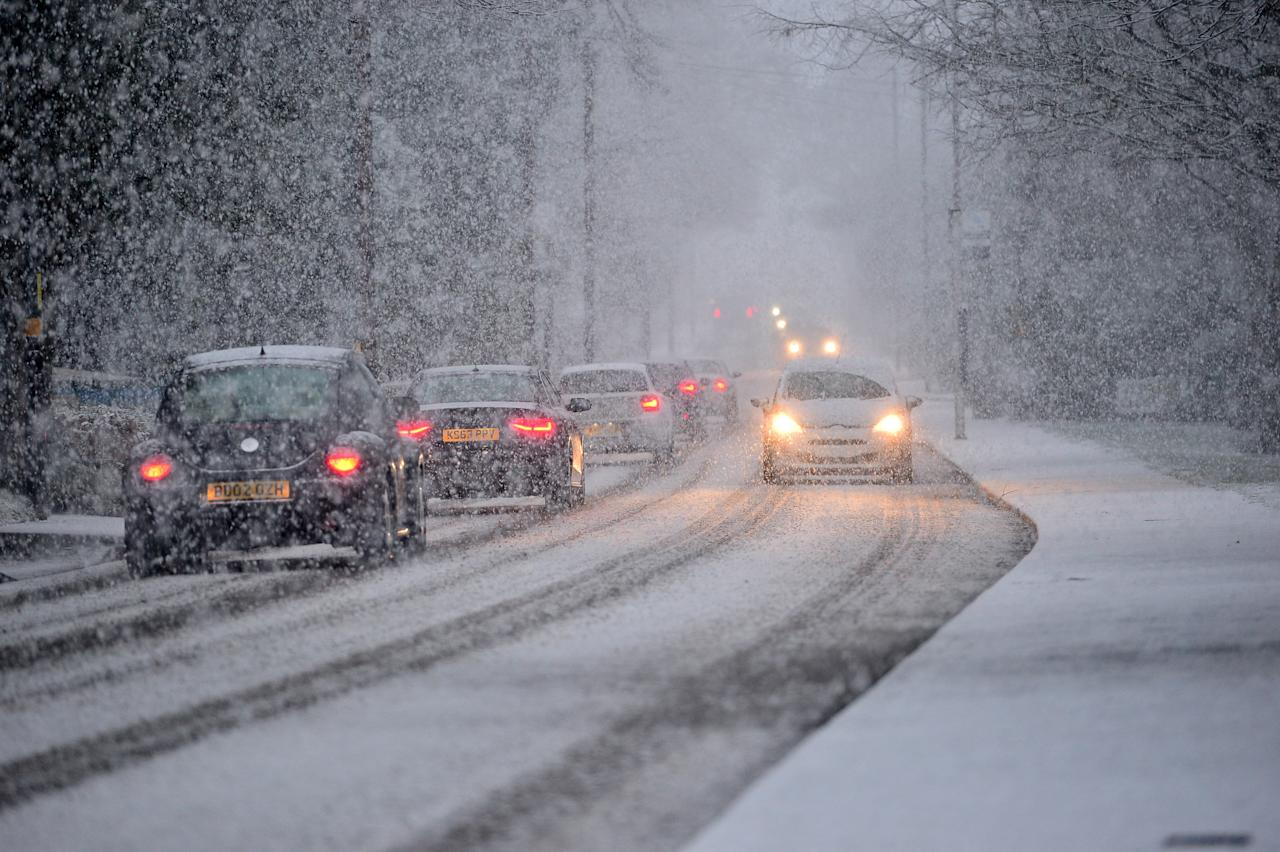 <p>Motorists battle through blizzardy conditions in Birmingham during rush hour snowfall. (SWNS) </p>