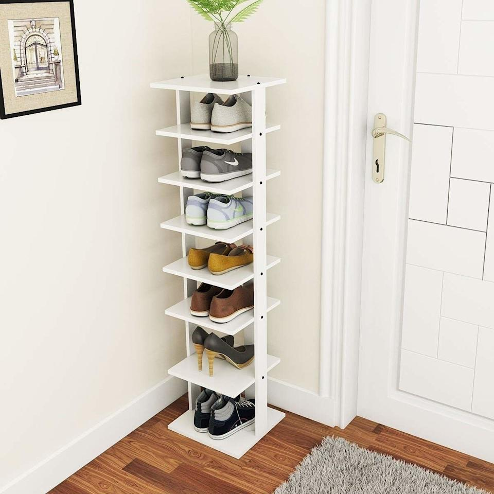 """Put this in your entryway, and it will look organized and elevated. Not to mention, you won't trip over a pile of shoes every time you come home.<br /><br /><strong>Promising review:</strong>""""My hubby looked all over for a tall and narrow shoe stand. This one was perfect. He tucked it in between a dresser and a wall and it fit perfectly.<strong>This is very sturdy, well balanced, and looks nice.</strong>I would definitely buy it again if I needed one."""" —<a href=""""https://www.amazon.com/gp/customer-reviews/R2A6H4GZZY7VA4?&linkCode=ll2&tag=huffpost-bfsyndication-20&linkId=5e700d36c367cef03258ed064f992072&language=en_US&ref_=as_li_ss_tl"""" target=""""_blank"""" rel=""""nofollow noopener noreferrer"""" data-skimlinks-tracking=""""5854435"""" data-vars-affiliate=""""Amazon"""" data-vars-href=""""https://www.amazon.com/gp/customer-reviews/R2A6H4GZZY7VA4?tag=bfmal-20&ascsubtag=5854435%2C9%2C37%2Cmobile_web%2C0%2C0%2C16324249"""" data-vars-keywords=""""cleaning,fast fashion"""" data-vars-link-id=""""16324249"""" data-vars-price="""""""" data-vars-product-id=""""20942385"""" data-vars-product-img="""""""" data-vars-product-title="""""""" data-vars-retailers=""""Amazon"""">KH<br /><br /></a><strong>Get it from Amazon for<a href=""""https://www.amazon.com/Tangkula-Entryway-Organizer-Multi-Function-Vertical/dp/B07R6D3MG2?&linkCode=ll1&tag=huffpost-bfsyndication-20&linkId=85ad5ffac484bf362cb8e5ca5867f80f&language=en_US&ref_=as_li_ss_tl"""" target=""""_blank"""" rel=""""nofollow noopener noreferrer"""" data-skimlinks-tracking=""""5854435"""" data-vars-affiliate=""""Amazon"""" data-vars-asin=""""B07BHG8643"""" data-vars-href=""""https://www.amazon.com/dp/B07BHG8643?tag=bfmal-20&ascsubtag=5854435%2C9%2C37%2Cmobile_web%2C0%2C0%2C16323361"""" data-vars-keywords=""""cleaning,fast fashion"""" data-vars-link-id=""""16323361"""" data-vars-price="""""""" data-vars-product-id=""""17989311"""" data-vars-product-img=""""https://m.media-amazon.com/images/I/41ptCOz7RlL._SL500_.jpg"""" data-vars-product-title=""""Tangkula 7 Tiers Vertical Shoe Rack, Entryway Wooden Shoes Racks, Modern Shoe Rack Organizer, Space Saving Shoes Storage Stand, St"""