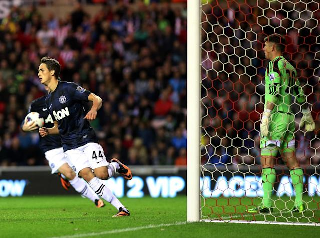 Manchester United's Adnan Januzaj celebrates scoring his goal during their English Premier League soccer match against Sunderland at the Stadium of Light, Sunderland, England, Saturday, Oct. 5, 2013. (AP Photo/Scott Heppell)