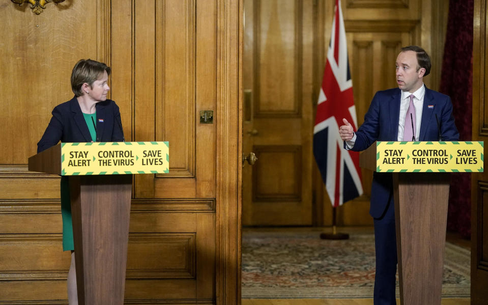 In this photo issued by 10 Downing Street,  Executive Chair of NHS Test and Trace, Baroness Dido Harding, left and Britain's Health Secretary Matt Hancock take part in a coronavirus media briefing in Downing Street, London, Thursday June 11, 2020. (Andrew Parsons/10 Downing Street via AP)