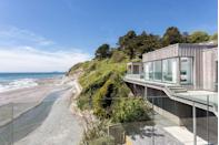 "<p>Seaton House is an award-winning, eco-friendly waterside home featuring a beach on its doorstep to provide stunning panoramic sea views. The property has four bedrooms, three bathrooms, and a terrace that wraps around the house with a heated outdoor pool, hot tub, pool house and <a href=""https://www.housebeautiful.com/uk/garden/g32185721/fire-pit/"" rel=""nofollow noopener"" target=""_blank"" data-ylk=""slk:fire pit"" class=""link rapid-noclick-resp"">fire pit</a>. It also features steps leading directly down to the beach, perfect if you fancy a quick dip in the sea or an idyllic stroll along the shoreline.</p><p><a class=""link rapid-noclick-resp"" href=""https://www.rightmove.co.uk/properties/94159754#/"" rel=""nofollow noopener"" target=""_blank"" data-ylk=""slk:TOUR NOW"">TOUR NOW</a></p>"