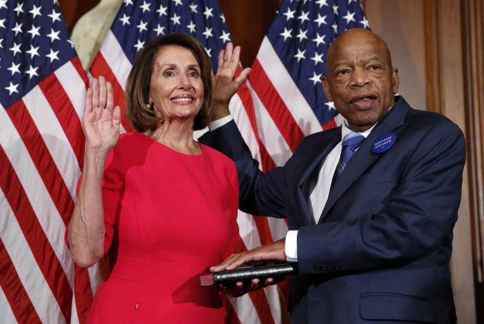 House Speaker Nancy Pelosi of Calif., left, poses during a ceremonial swearing-in with Rep. John Lewis, D-Ga., right, on Capitol Hill on Jan. 3, 2019 in Washington  during the opening session of the 116th Congress.. (Photo: Alex Brandon/AP)
