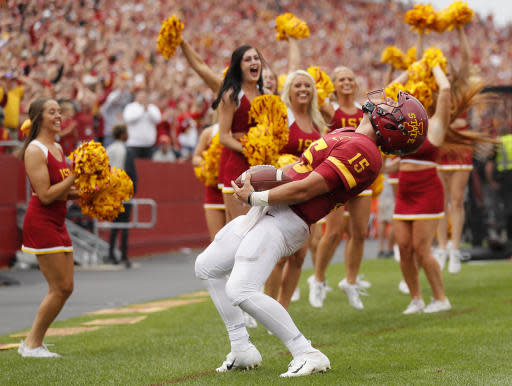 Iowa State quarterback Brock Purdy celebrates after scoring a touchdown at the end of regulation that was called back for holding during the second half of an NCAA college football game, Saturday, Aug. 31, 2019, in Ames. Iowa State won 29-26 in triple overtime. (AP Photo/Matthew Putney)
