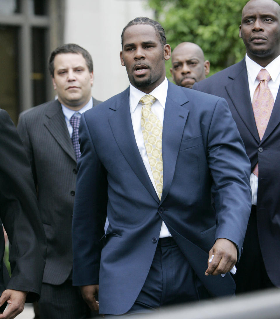 FILE - R&B singer R. Kelly leaves the Cook County Criminal Court Building on June 13, 2008, in Chicago. Kelly was acquitted on all counts after less than a full day of deliberations. The 54-year-old R&B singer will once again head to court this week. His federal trial in New York begins Wednesday, Aug. 18. 2021, and will explore years of sexual abuse allegations. He has vehemently denied the allegations against him. (AP Photo/Nam Y. Huh, File)