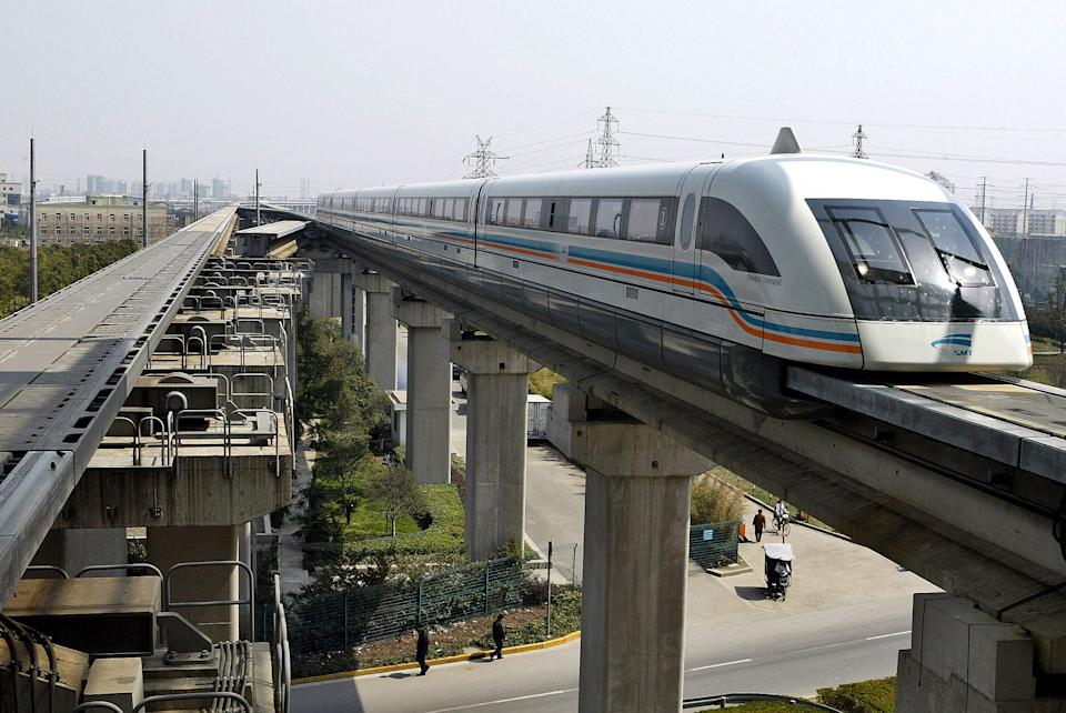 A maglev train drives into a terminal station in Shanghai March 14, 2006. French engineering group Alstom aims to increase its metro equipment sales in China this year as the nation's cities expand their subway networks, a top company executive said on Tuesday. REUTERS/Ming Ming