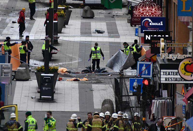 Emergency services work at the scene where a truck crashed into the Ahlens department store at Drottninggatan in central Stockholm, April 7, 2017