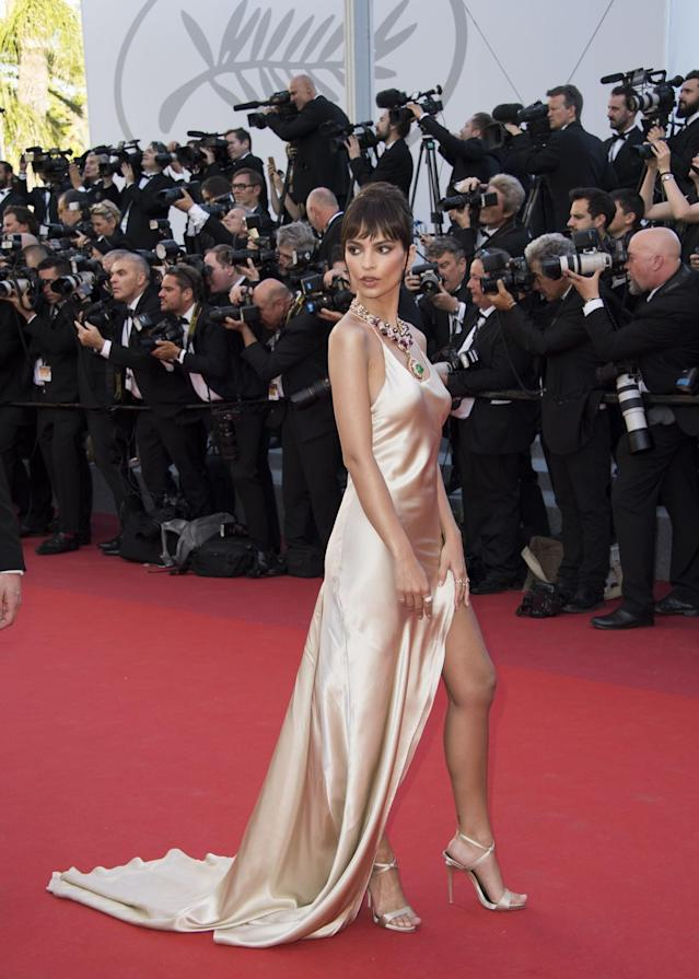 <p>The model and actress opted for a champagne-colored silk gown that she paired with a stunning necklace made from diamonds, rubies, and emeralds. (Photo: AP) </p>