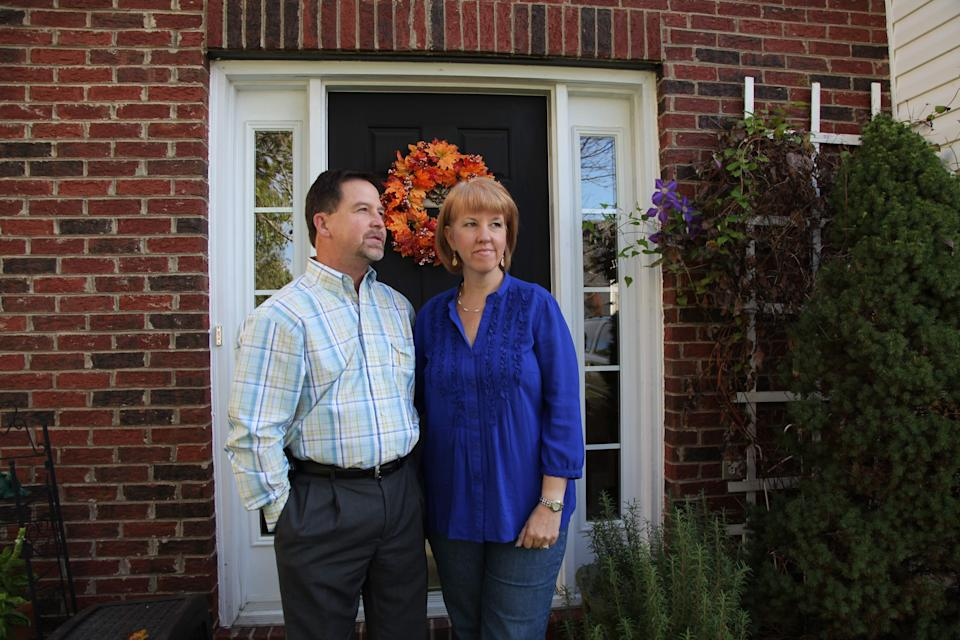 In this Oct. 19, 2012, photo, Ray and Candice Arvin pose outside their home in Charlotte, N.C. Romney supporter, Arvin used to own a small business with five employees, selling equipment to power companies, but he went out of business in 2009. He's now a salesman for another equipment company. Polls consistently find that the economy is the top concern of voters, and Romney tends to get an edge over Obama when people are asked who might do better with it. Whether that truly drives how Americans vote is a crucial question for Election Day. (AP Photo/Robert Ray)