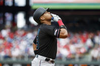 Miami Marlins' Starlin Castro reacts after hitting a home run off Philadelphia Phillies relief pitcher Blake Parker during the second inning of a baseball game, Sunday, Sept. 29, 2019, in Philadelphia. (AP Photo/Matt Slocum)