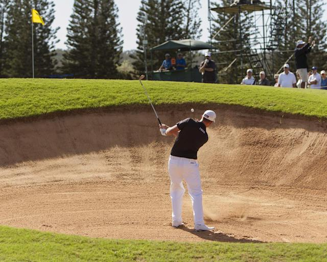 Webb Simpson hits out of a bunker on the second green during the final round of the Tournament of Champions golf tournament, Monday, Jan. 6, 2014, in Kapalua, Hawaii. (AP Photo/Marco Garcia)