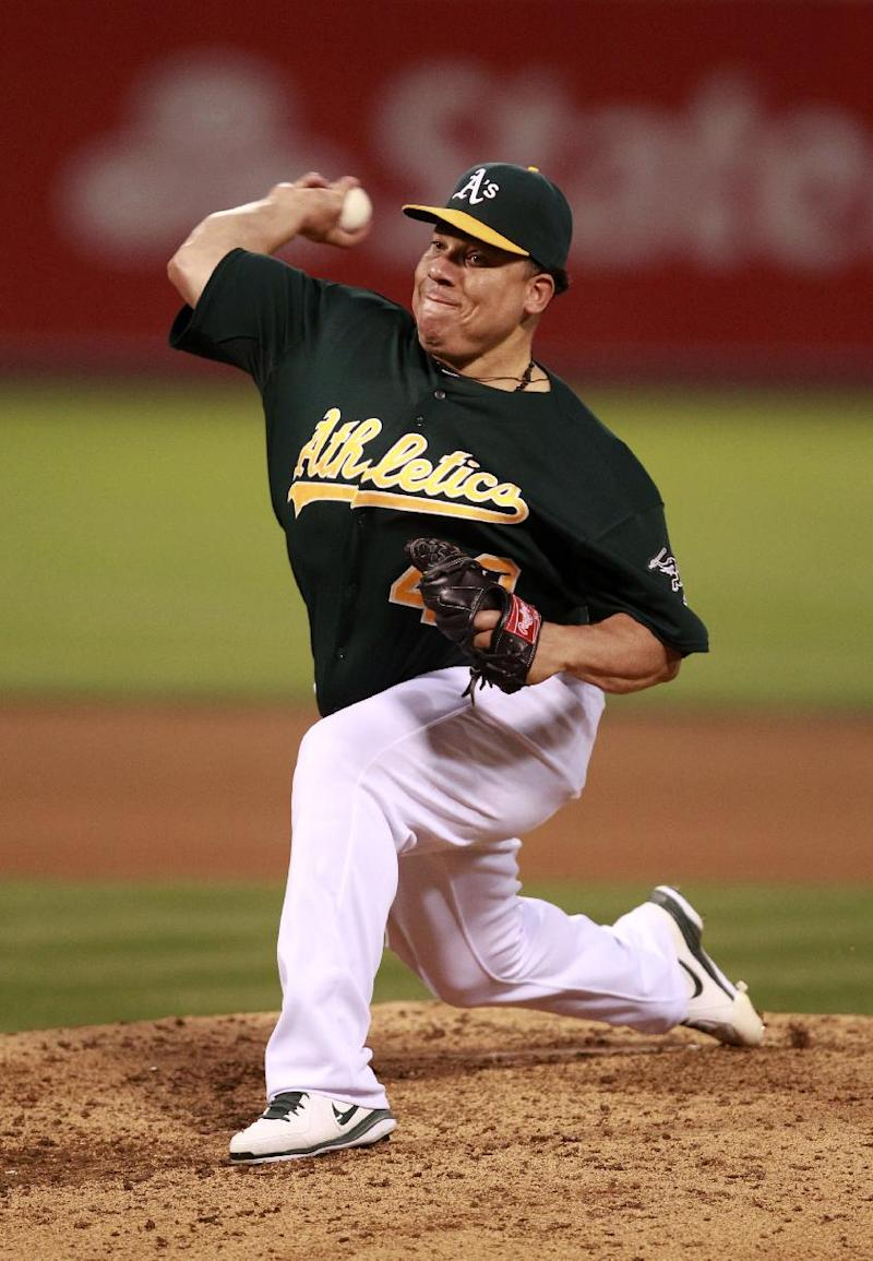 Colon earns 14th win pitches A's past Angels
