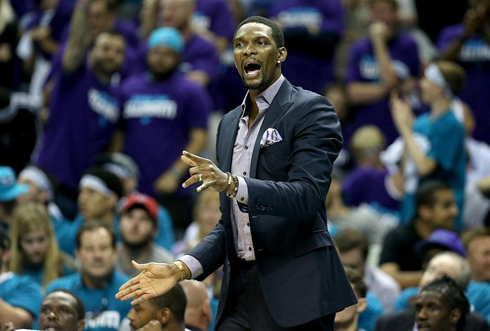 Chris Bosh watches from the bench as the Miami Heat take on the Charlotte Hornets during Game 4 of the 2016 Eastern Conference Quarterfinals. (Streeter Lecka/Getty Images)
