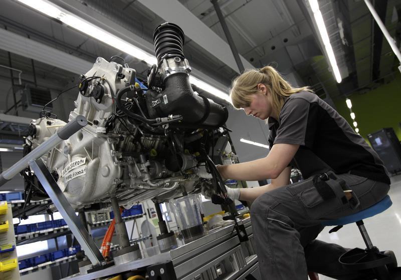 Worker assembles engine for new Porsche 918-Spyder sports car at production line of German car manufacturer's plant in Stuttgart