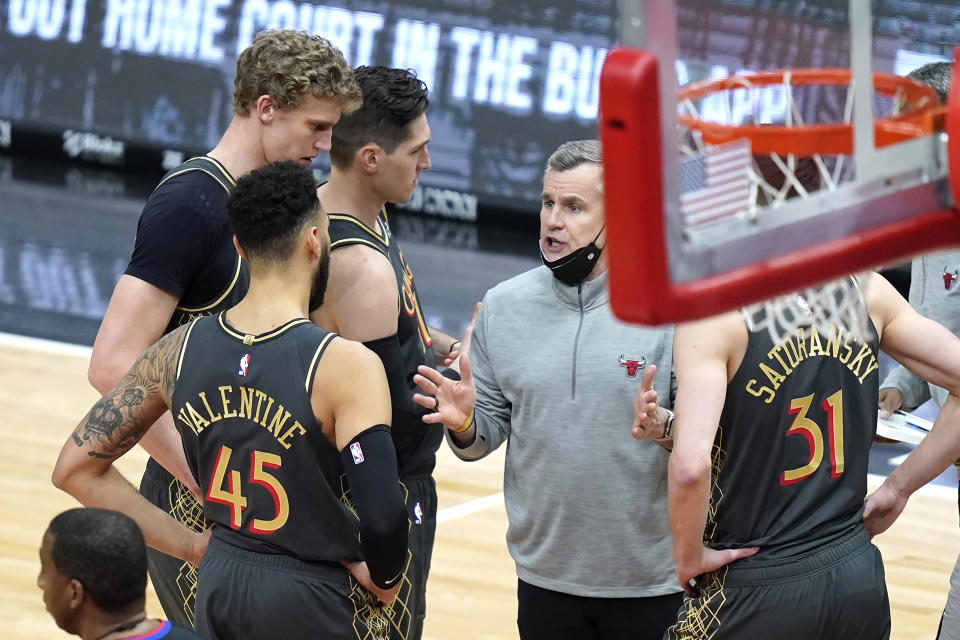 Chicago Bulls head coach Billy Donovan, second from right, talks to his players during a timeout in the second half of an NBA basketball game against the Charlotte Hornets, Thursday, April 22, 2021, in Chicago. (AP Photo/Charles Rex Arbogast)