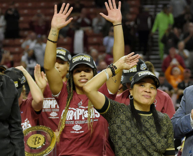 FILE - In this March 8, 2020, file photo, South Carolina head coach Dawn Staley, right, and Tyasha Harris acknowledge the crowd after defeating Mississippi State in a championship match at the Southeastern Conference women's NCAA college basketball tournament in Greenville, S.C. South Carolina is No. 1 in the final Associated Press women's basketball poll of the season for the first time in school history. (AP Photo/Richard Shiro, File)
