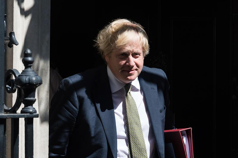 LONDON, UNITED KINGDOM - MAY 06, 2020: British Prime Minister Boris Johnson leaves 10 Downing Street for PMQs at the House of Commons on 06 May, 2020 in London, England. Tomorrow, Boris Johnson is expected to extend the UK's nationwide lockdown imposed on March 23 to slow down the spread of the Coronavirus disease.- PHOTOGRAPH BY Wiktor Szymanowicz / Barcroft Studios / Future Publishing (Photo credit should read Wiktor Szymanowicz/Barcroft Media via Getty Images)
